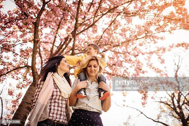 Piggyback ride under the cherry blossom tree