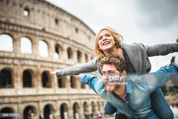 piggybacking for st. valentine in rome - coliseum rome stock photos and pictures