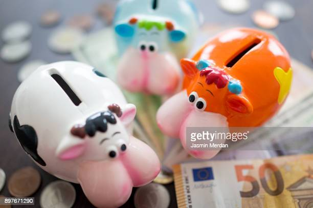 Piggybank stuffed with different world currencies
