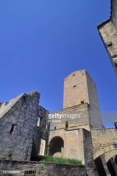 pignan, square tower, in pignan stones - hérault stock pictures, royalty-free photos & images