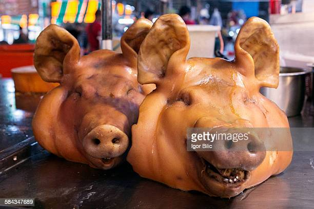 Pig's head for sale at a market in Bangkok