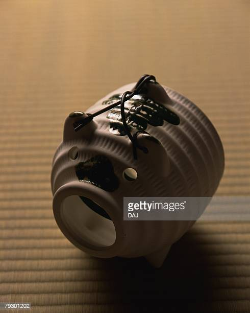 Pig-shaped incense burner on Tatami mat, high angle view, differential focus, Japan