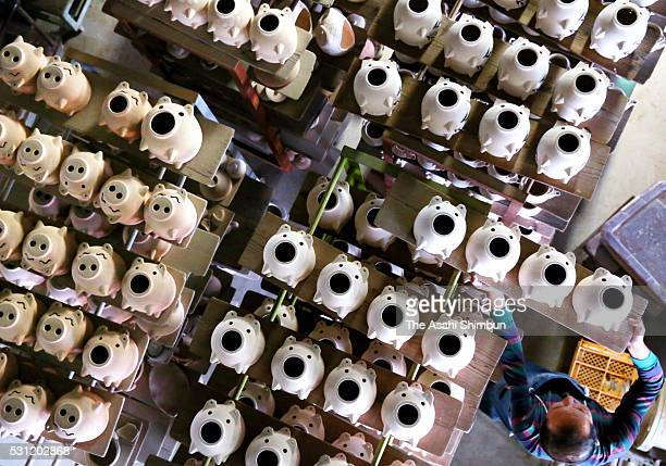 Pigshaped mosquito coil holders await the finishing touches at the factory of pottery maker Matsuo Seitojo on May 10 2016 in Komono Mie Japan Kayari...