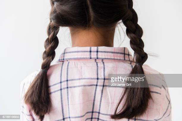 Pigtail braids of Mixed Race girl