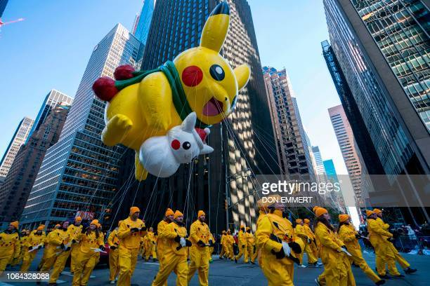 TOPSHOT Pikachu and Snow Pikachu fly over 6th Avenue during the 92nd Annual Macy's Thanksgiving Day Parade on November 22 in New York