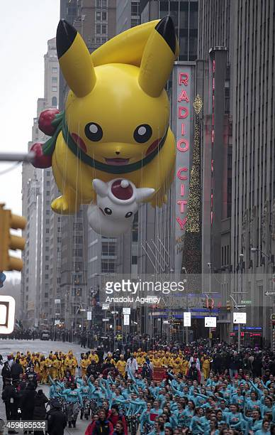 Pikachu balloon floats for the 88th Annual Thanksgiving Day Parade outside Macy's Department Store in Herald Square on November 27 2014 in New York...