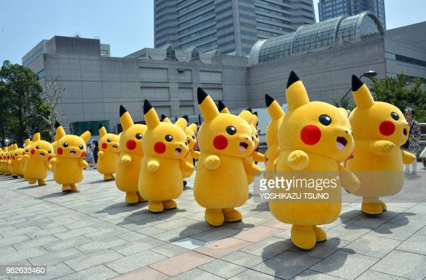 20 Pikachu characters Nintendo's videogame software Pokemon's wellknown character march at a shopping mall in Yokohama suburban Tokyo on August 10...