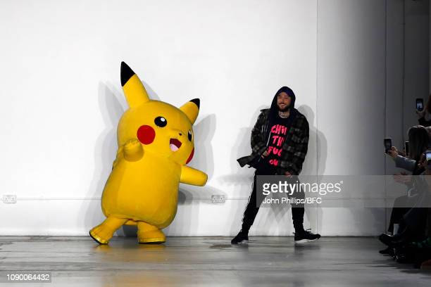 Pikachu with designer Bobby Abley on the runway during the finale of the Bobby Abley show during London Fashion Week Men's January 2019 at the BFC...