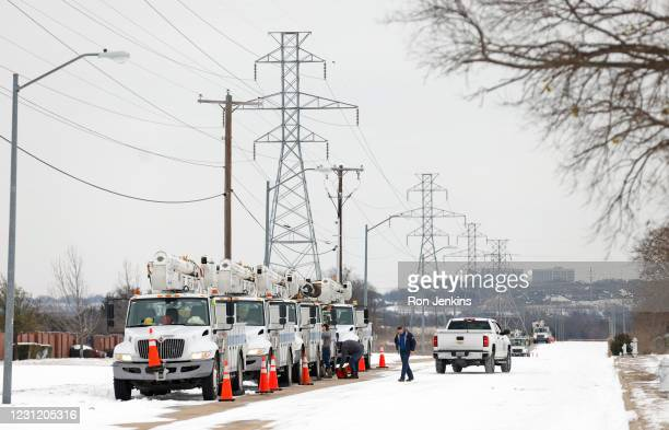 Pike Electric service trucks line up after a snow storm on February 16, 2021 in Fort Worth, Texas. Winter storm Uri has brought historic cold weather...