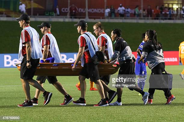 Pikul Khueanpet of Thailand is carried off the pitch on a stretcher by medical personnel during the FIFA Women's World Cup Canada 2015 Group B match...