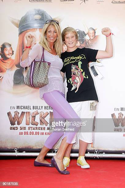 Pilar Brehme and son Alessio attend the premiere of 'Vicky The Viking' at Mathaeser cinema on August 30 2009 in Munich Germany