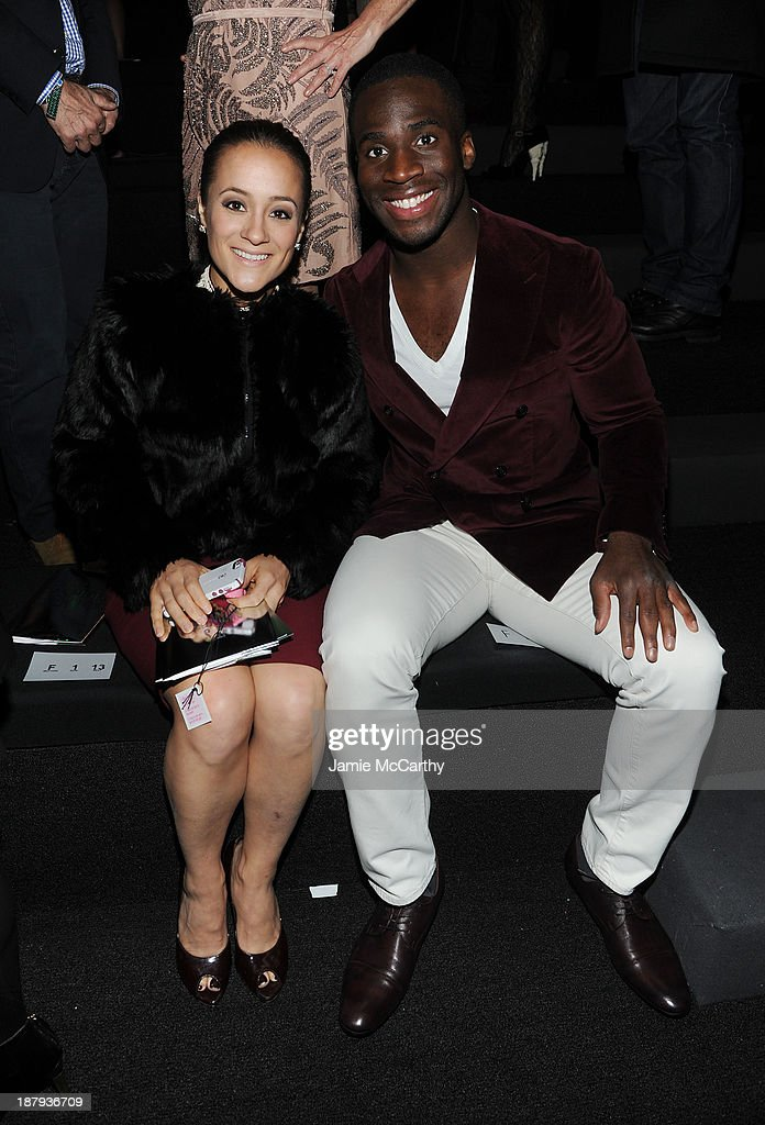 Pilar Davis and Prince Amukamara attend the 2013 Victoria's Secret Fashion Show at Lexington Avenue Armory on November 13, 2013 in New York City.