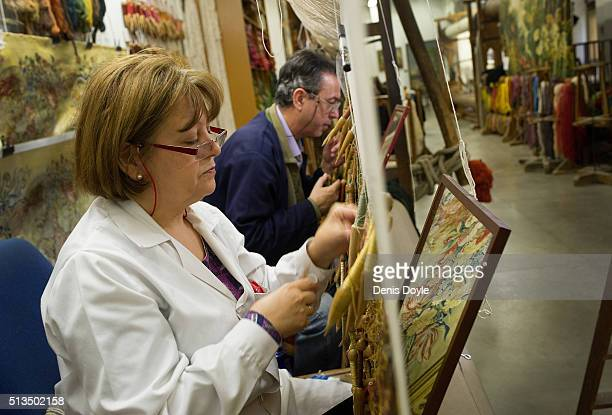 Pilar Felguera and Jose Antonio Carbajal work on a tapestry for rebuilt Residenzscholss in Dresden at the Royal Tapestry Factory on March 3 2016 in...