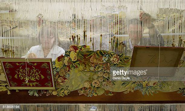 Pilar Felguera and Jose Antonio Carbajal work on a tapestry for rebuilt Residenzschloss in Dresden at the Royal Tapestry Factory on March 3 2016 in...