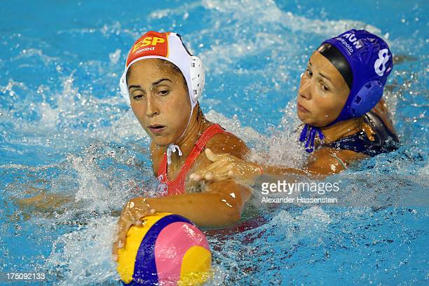 Pilar Pena of Spain in action with Ibolya Kitti Miskolczi of Hungary during the Women's Water Polo Semifinal Round between Spain and Hungary during...