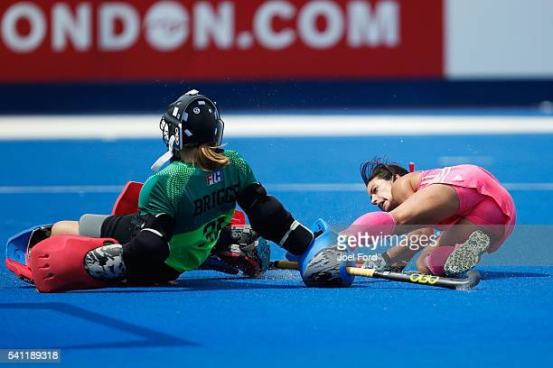 Pilar Romang of Argentina is stopped by USA goalkeeper Jackie Briggs of the USA plays a pass during the FIH Women's Hockey Champions Trophy 2016...