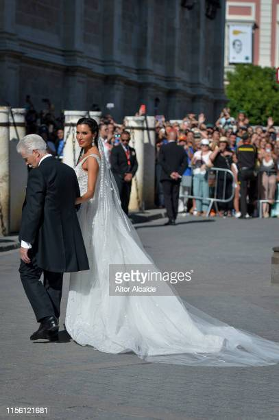 Pilar Rubio and father Manuel Rubio attend the wedding of real Madrid football player Sergio Ramos and Tv presenter Pilar Rubio at Seville's...