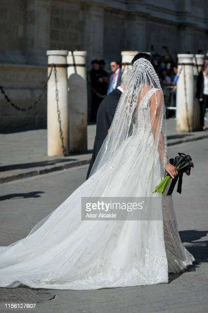 Pilar Rubio attends the wedding of real Madrid football player Sergio Ramos and Tv presenter Pilar Rubio at Seville's Cathedral on June 15 2019 in...