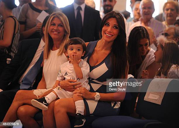 Pilar Rubio smiles with her son Sergio Ramos Junior during her husband's Sergio Ramos' announcement of his new fiveyear contract with Real Madrid at...