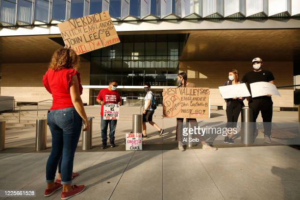 Pilar Schiavo left cofounder of West Valley Peoples Alliance joined the group as they gathered in front of Los Angeles federal courthouse while...