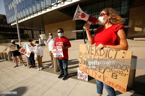 Pilar Schiavo right cofounder of West Valley Peoples Alliance joined the group as they gathered in front of Los Angeles federal courthouse while...