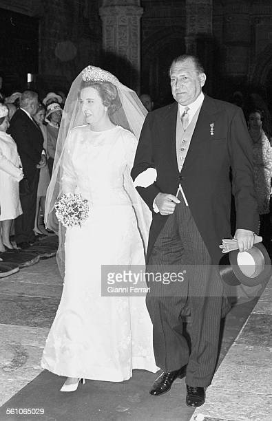Pilar sister of King Juan Carlos de Borbon the day of her wedding to Luis Gomez Acebo was escorted to the altar by her father Don Juan de Borbon...