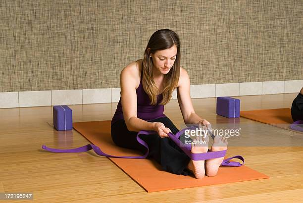 pilates class stretch with straps - strap stock pictures, royalty-free photos & images