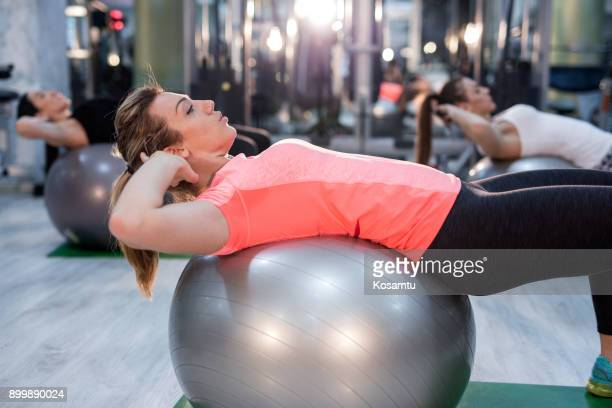 pilates crunch abs exercise - sit ups stock photos and pictures