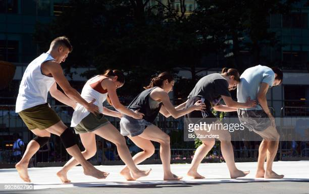 Pilates exercising on the fountain Terrace in Bryant Park, in New York City.
