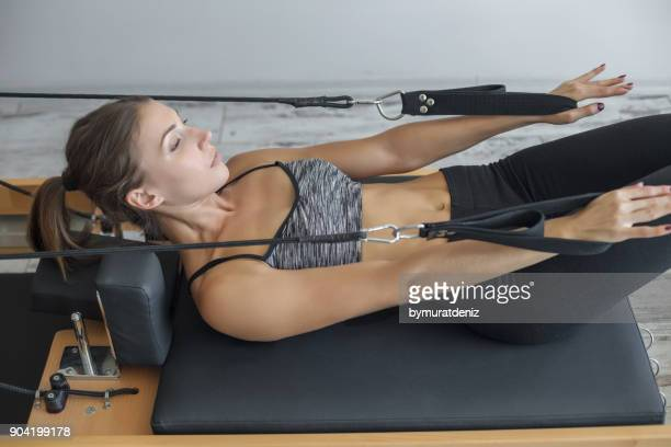 pilates reformer - pilates stock pictures, royalty-free photos & images