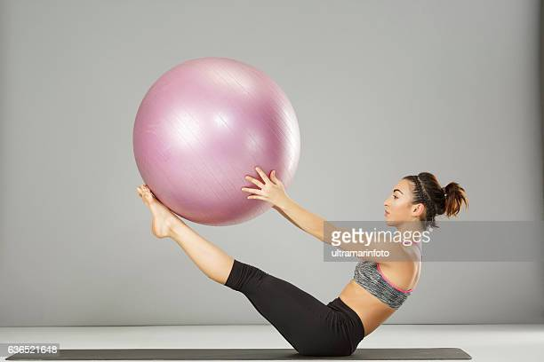 Pilates stretching  training   Woman practicing on a fitness ball