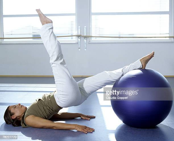 Pilates training performed by woman in gym