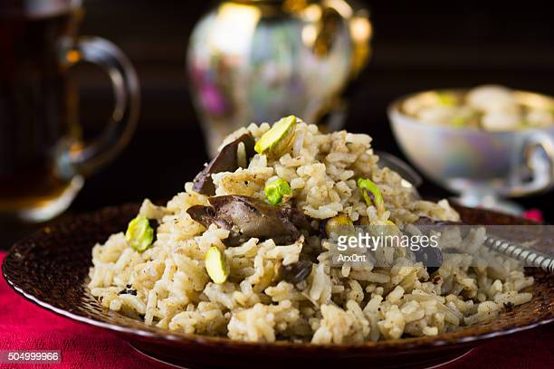 Pilau (plov, pilaf) with chicken and pistachios