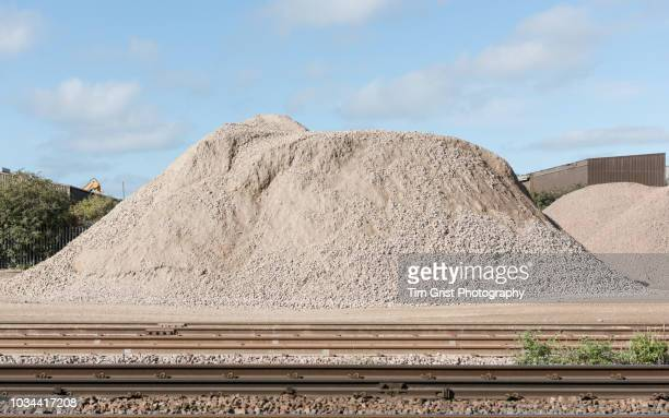 pile of aggregate in a yard - gravel stock pictures, royalty-free photos & images