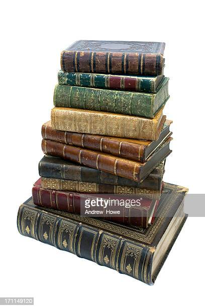pile of antique books - thick stock photos and pictures