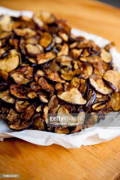 a pile of aubergine chips - breaded stock photos and pictures