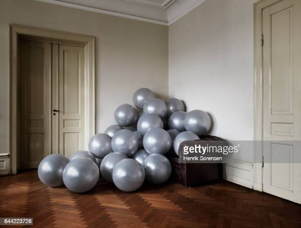 A pile of balloon laying on a couch
