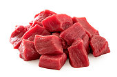 Pile of beef cubes isolated on white.