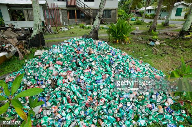 pile of beer cans in garden - pacific islands stock pictures, royalty-free photos & images