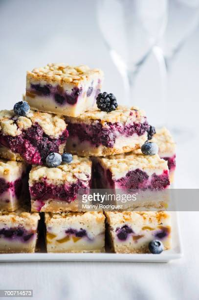 Pile of berry cobbler slices on tray