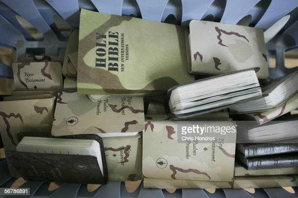 Pile of Bibles printed for the military sit in a bin in the dining hall of the field base for Lima company of the 3rd Battalion, 7th Regiment of the...
