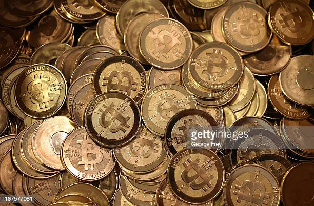 A pile of Bitcoin slugs sit in a box ready to be minted by Software engineer Mike Caldwell in his shop on April 26 2013 in Sandy Utah Bitcoin is an...