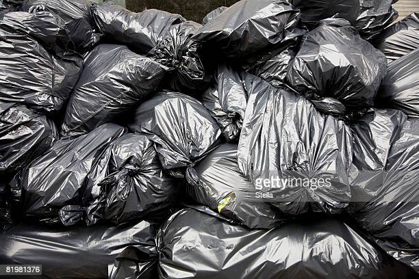 A pile of black rubbish bags