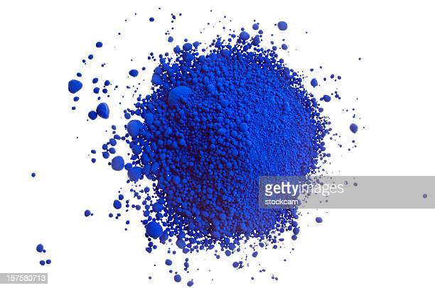 Pile of blue pigment powder on white close-up