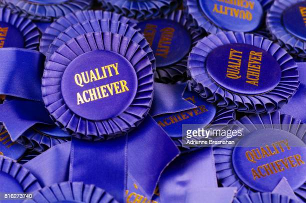 Pile of Blue Ribbons for Quality Achievement