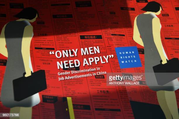 TOPSHOT A pile of booklets entitled 'Only Men Need Apply' is displayed during a press conference upon the launch of a new report by Human Rights...