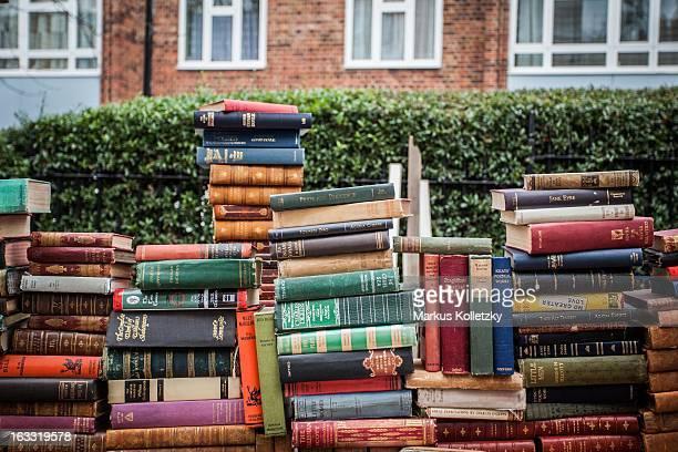 Pile of books on Portobello Road Market, a flew market in Notting Hill, London.