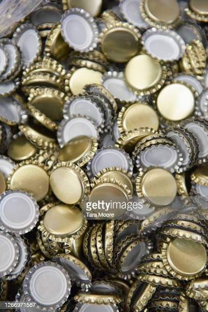 pile of bottle cap - heap stock pictures, royalty-free photos & images