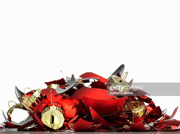 pile of broken christmas ornaments