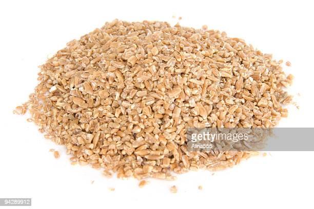 pile of bulgar wheat on white - bulgur bildbanksfoton och bilder